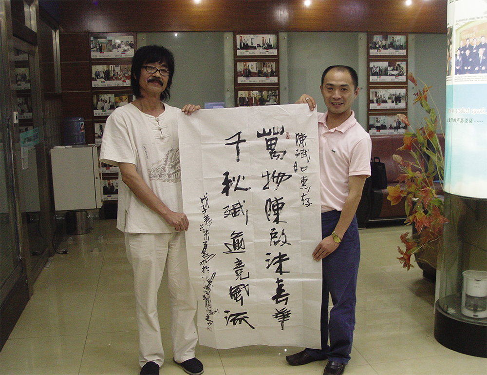 Mr Zhangyulong,famous Chinese Calligrapher,President of Chinese Yijing Feng Shui Painting Research Institute,Chinese Daoshu top Calligrapher Guinness world record holder ,live performed Calligraphy fo